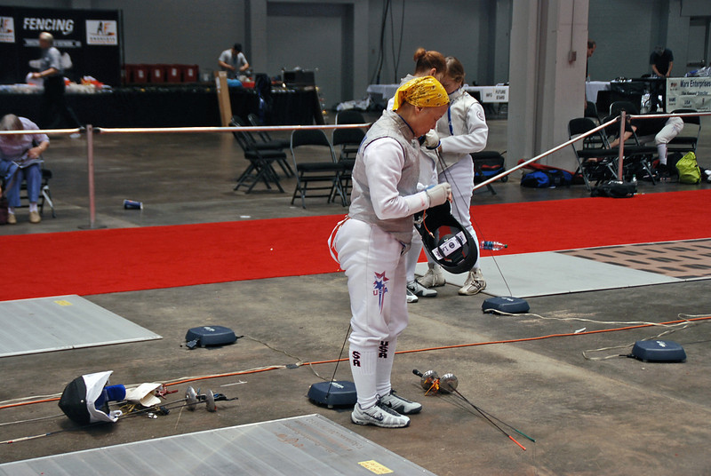 Bettie Graham prepares to compete in the Veteran-70+ Women's Foil.