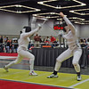 Katharine Holmes (right) fences Isis Washington in the round of 8 of Junior Women's Epee.