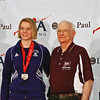 Courtney Dumas receives her 8th place medal from Dan DeChaine in the Junior Women's Epee.