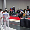 Ella Barnes shakes Jessie O'Neill's hand after losing 15-12 in the DE bout in the Division I Women's Epee.