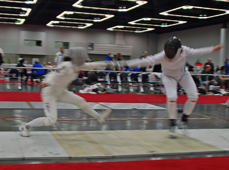 Katharine Holmes (right) vs Isabel Ford in Table E of the repechage in the Division I Women's Epee.