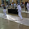 William Foster scores a touch in the direct elimination of the Youth-12 Men's Epee.
