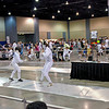 Nicholas McGrew (right) scores a touch n the Youth-14 Men's Epee.