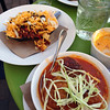 Frito Pie (vegetarian chili, cheddar cheese, onions) and pork and house-chorizo meatballs, chili grits, pozole broth at Pasture Restaurant.
