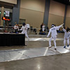 William Foster scores on his opponent in the Youth-12 Men's Epee.