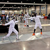 Levi Freedman (left) in the Youth-14 Men's Epee.