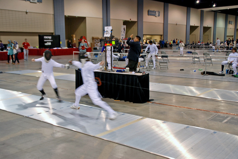 Toby Matus-Bond scores a touch in the Youth-14 Men's Epee.
