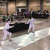 Bryce Knight (left) in the Youth-10 Men's Epee.