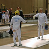 Bettie Graham's checks the epee guards before her semi-final bout with Pat Bedrosian.
