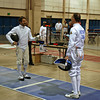Mark Henry prepares to fence Peter Calderon in the quarter-final bout of the Veteran-70+ Men's Epee.