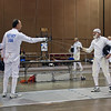 Mark Henry tests guards vs. Richard Dunlop in the Veteran-70+ Men's Epee preliminary round.
