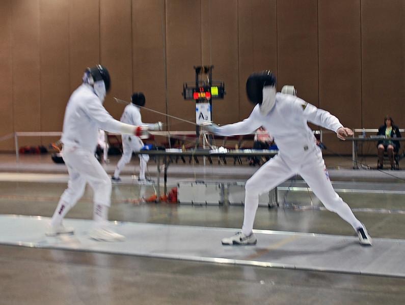 Mark Henry (right) vs. Edward Sady in the preliminary round of the Veteran-70+ Men's Epee.