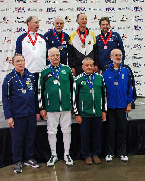 The finalists in the Veteran-70+ Men's Epee.  From left: top row: Ray Sexton (2nd), Kaz Campe (1st), Mark Henry (3rd), Peter Calderon (3rd).  Bottom Row: James Adams (5th), John McGrew (6th), Barry Leonardini (7th), and Donald Penner (8th).