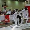 William Foster (right) in the Youth-12 Men's Epee.