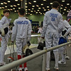 William Foster (left) gathers with the other members of his pool at the start of the Youth-12 Men's Epee.