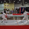 Bettie Graham (left) vs. Patricia Bedrosian in the Veteran-70+ Women's Epee preliminary round.