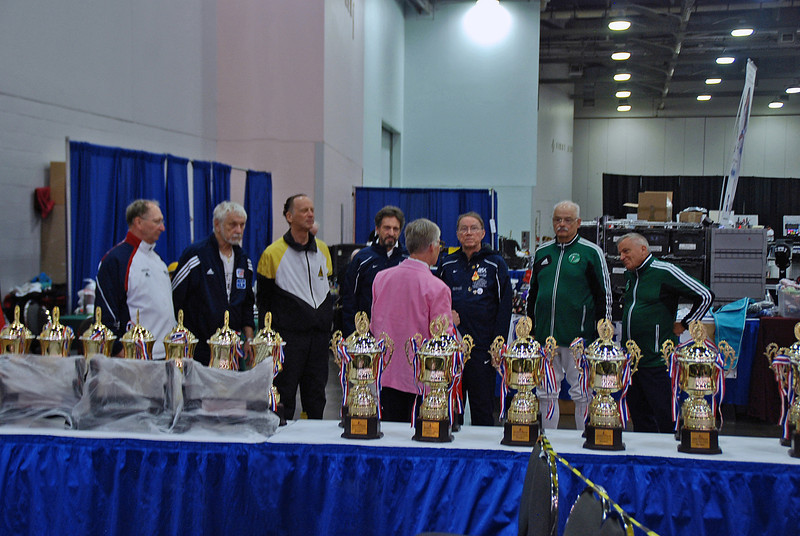 Carol Buerdsell prepares the finalists of the Veteran-70+ Men's Epee for the award ceremony.