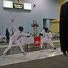 Julia Smith (left) in the first round of the Under-16 Women's Epee.