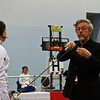 Referee George Porter checks Julia Smith's epee in the first round of the Under-16 Women's Epee.
