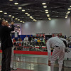 Referee Tim Bookwalter tests the weapon of Mark Henry in the Veteran-70+ Men's Epee.