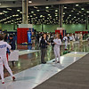 William Foster prepares to start his DE in the Youth-12 Men's Epee.