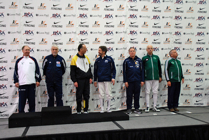 The finalists in the Veteran-70+ Men's Epee.  From left: Ray Sexton (2nd), Kaz Campe (1st), Mark Henry (3rd), Peter Calderon (3rd),  James Adams (5th), John McGrew (6th), Barry Leonardini (7th), and Donald Penner (8th, not pictured).