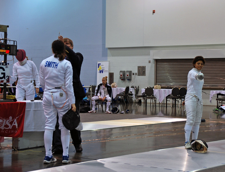 Referee Jim Vesper and Julia Smith in the Under-19 Women's Epee.