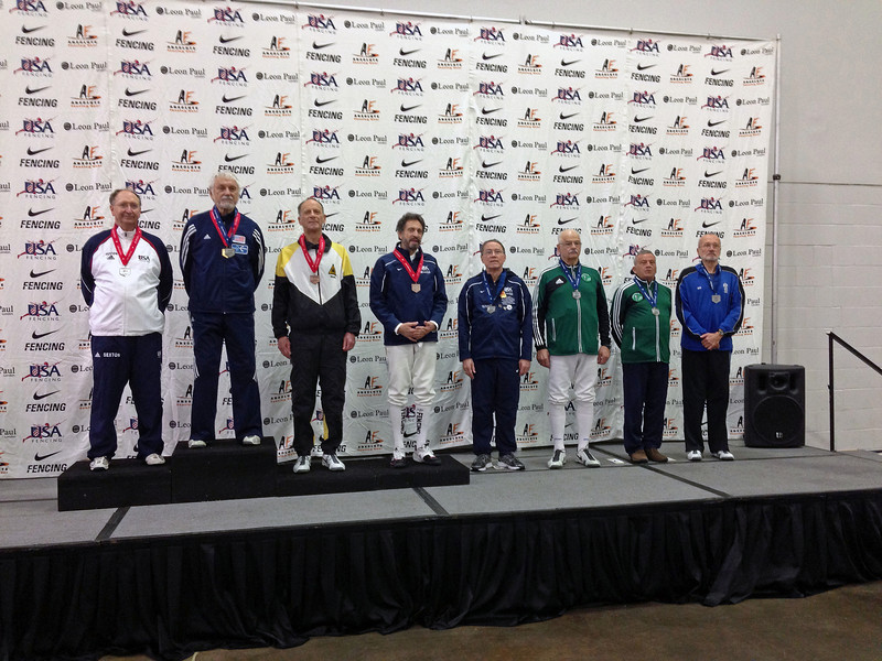 The finalists in the Veteran-70+ Men's Epee.  From left: Ray Sexton (2nd), Kaz Campe (1st), Mark Henry (3rd), Peter Calderon (3rd),  James Adams (5th), John McGrew (6th), Barry Leonardini (7th), and Donald Penner (8th).