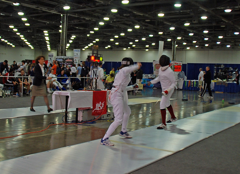 Julia Smith (left) in the DE of the Under-19 Women's Epee.
