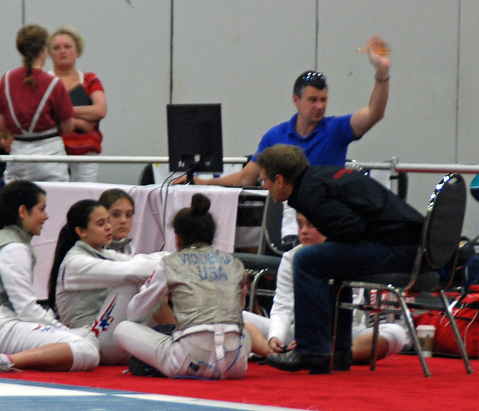 Fencing Master Buckie Leach talking to his women foil fencers.