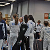 The pod gathers at the start of the direct elimination in the Cadet Women's Epee.