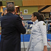 The referee checks India Bhalla-Ladd's epee in the Cadet Women's Epee.