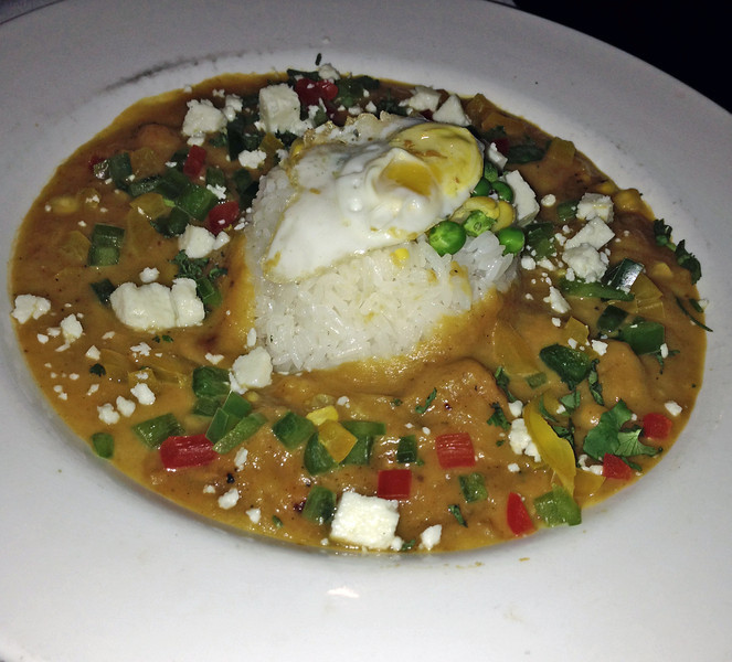 India ate a Peruvian dish called Locro Serrrano de Zapallo Andino, a savory squash stew with Andean tubers and cheese, served with garlic rice and a fried quail egg.