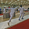 Jake Mezey (left)  in the Division III Men's Epee direct elimination round.