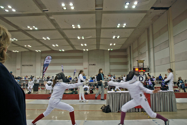 Emma Scala (left) in the Youth-14 Women's Epee.