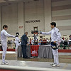 Jake Mezey (right) in the Youth-14 Men's Epee.