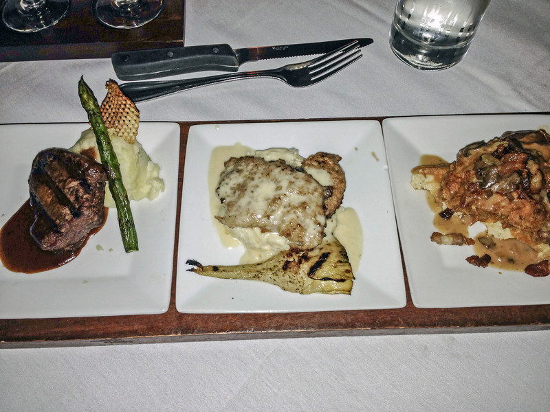 Entree flight (boursin stuffed filet with yukon gold potato puree, red wine bordelaise; veal scallopini with crispy veal cutlets, fried artichokes, parmesan orzo pasta, lemon caper butter; and chicken andwaffles with Ashley Farms chicken breast, buttermilk waffle, <br /> vermont maple syrup and local mushroom cream) at Flight Restaurant.