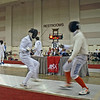 Jake Mezey (left) in the Youth-14 Men's Epee.