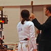 Julia Smith has her weapon tested in Division I Women's Epee.
