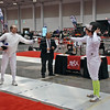 Raphael Hviding (right) tests guards in Division I Men's Epee.