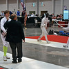 Referee George Nonomura checks Raphael Hviding's epee in Division I Men's Epee.