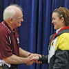 Nina Moiseiwitsch receives her silver medal from Dan DeChaine.