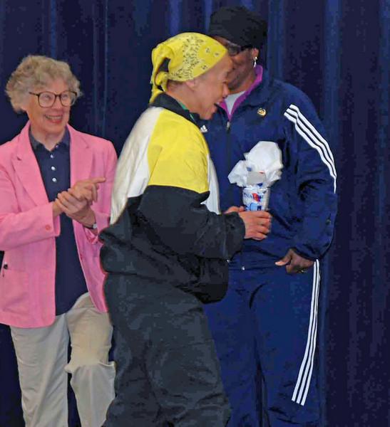 Bettie Graham receives her medal in the Veteran-60 Women's Epee.