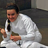 Nina Moiseiwitsch fixes her epee tip before the Division II Women's Epee event.