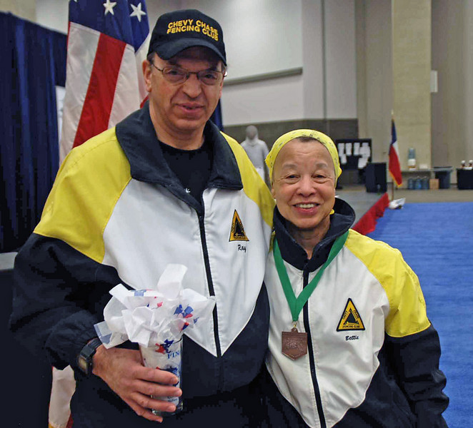 Fencing Master Raymond Finkleman with medalist Bettie Graham.
