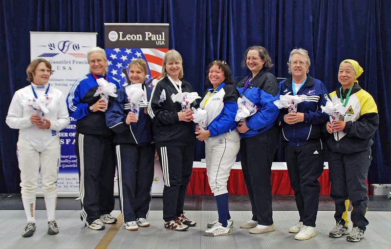 The finalists in Veteran-60 Women's Epee.  From left: Bonnie Aher (1st), Cynthia Runyon (2nd), Diane Kallus (3rd), Kathryn Rubin (3rd), Anna Estrada (5th), Sandra Schwartz (6th), Patricia Bedrosian (7th), and Bettie Graham (8th).
