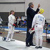 Referee Ed Richards check's Bettie Graham's epee in her bout versus Patricia Lutton in the Veteran-60 Women's Epee pool.