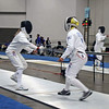 Bettie Graham (right) scores a touch on Patricia Lutton in the Veteran-60 Women's Epee pool.