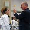 The referee checks Nina Moiseiwitsch's epee in the Division II Women's Epee.