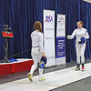 Nina Moiseiwitsch (left) checks guards with Mason Speta in the gold medal bout of Division II Women's Epee.